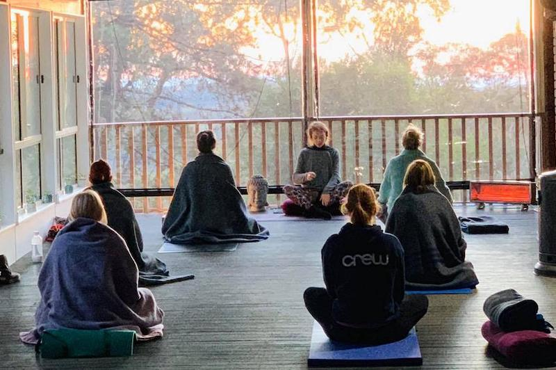 Retreaters sit in meditation and silence