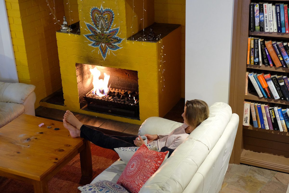 Happy Buddha Retreat cosy by the fire