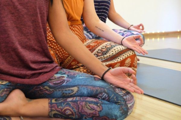 Close up of three woman seated for meditation