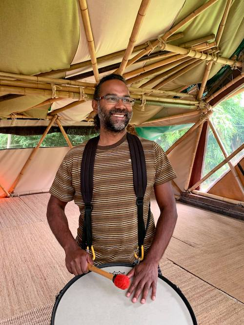 Athill Singh facilitating drumming workshop during happy buddha retreats blue mountains
